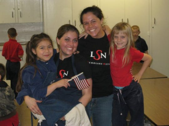Lilly Scholars Bryana Schreiber and Diane Embry volunteer with kids at IPS 58 on the east side.