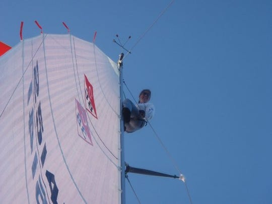 Michelle Kinney looks down from the mast during a Bell's Beer Bayview Mackinac Race. She will sail on the Knot Yours Too in this year's race.