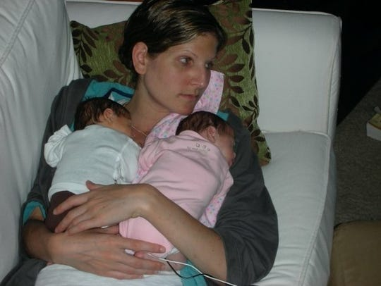 Liz Braatz snuggles with her twins Carter and Emma.