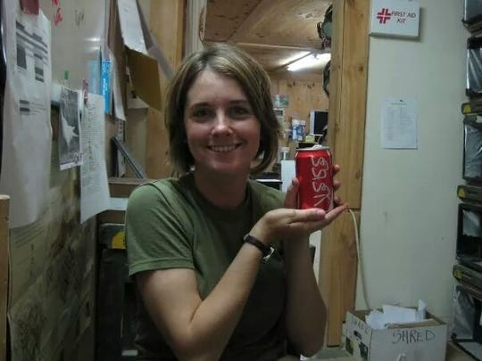 Tegan Griffith proudly displaying a Coca-Cola she got