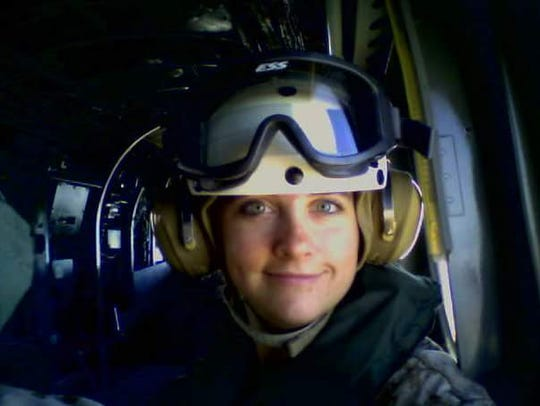 Tegan Griffith flying in a helicopter as part of a