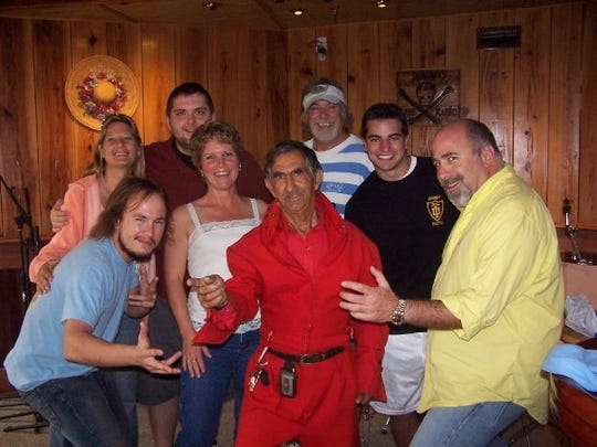 Norman Webb, better known as Boardwalk Elvis, wore a red jumpsuit during a visit to the Ocean 98 studio after the radio station raised money to replace Webb's electric bicycle in 2013.