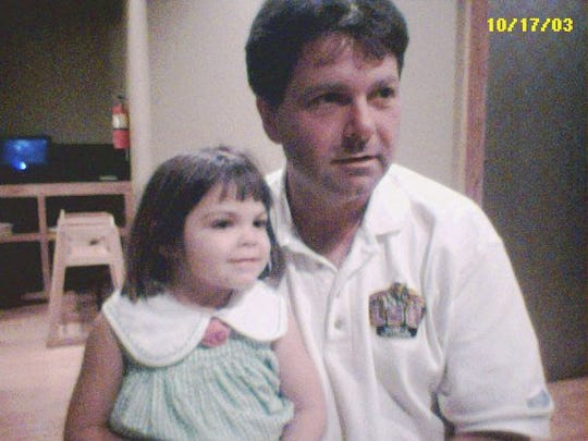 Alyssa and her father in 2003.