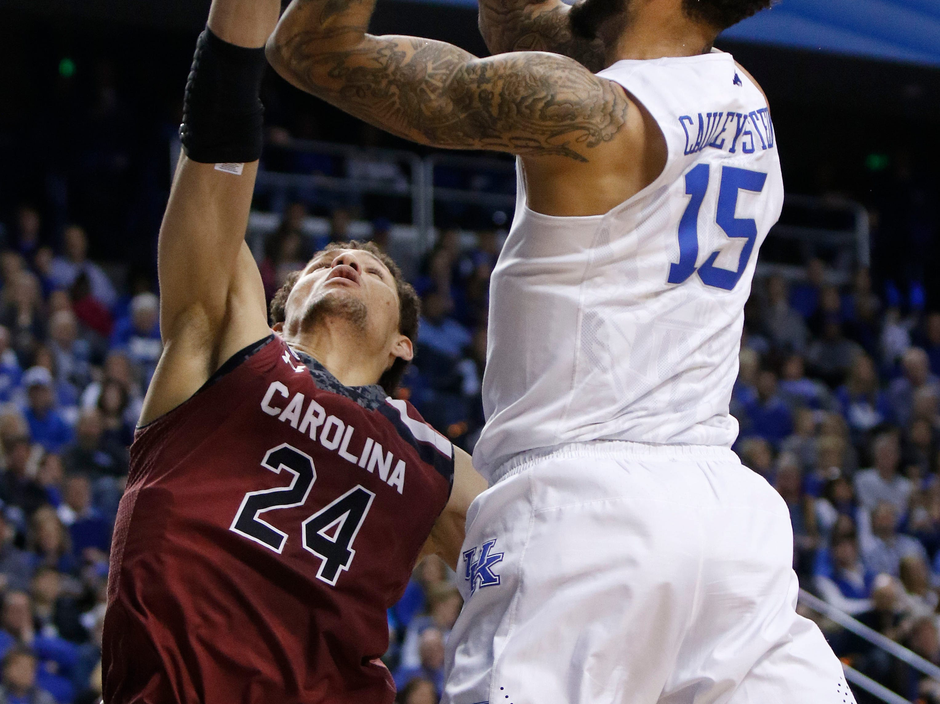 Kentucky's Willie Cauley-Stein (15) shoots while defended by South Carolina's Michael Carrera (24) during the first half of an NCAA college basketball game, Saturday, Feb. 14, 2015, in Lexington, Ky. Kentucky won 77-43. (AP Photo/James Crisp)