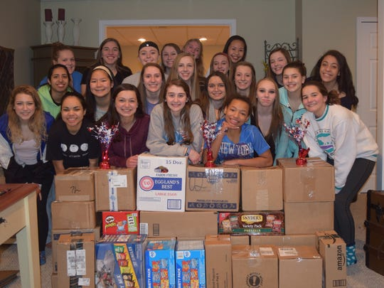 Livonia Blue's gymnastics team collected 24 boxes of