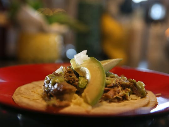 Carnitas tacos, with slow cooked pork shoulder, avocado