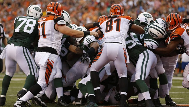 Cincinnati Bengals running back Giovani Bernard (25) with the help of his lineman pushes his way across the end zone for a first quarter touchdown against the New York Jets at Paul Brown Stadium.