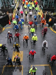 Cyclists board the ferry Tacoma at Colman Dock in Seattle heading to Sunday's Chilly Hilly on Bainbridge Island.