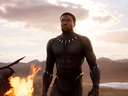 """This image released by Disney and Marvel Studios' shows Chadwick Boseman in a scene from """"Black Panther,"""" in theaters on Feb. 16, 2018. (Marvel Studios/Disney via AP) ORG XMIT: CAET868"""