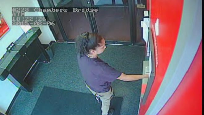 Township police say a woman used an ATM card left behind at the Santander Bank on Route 70.