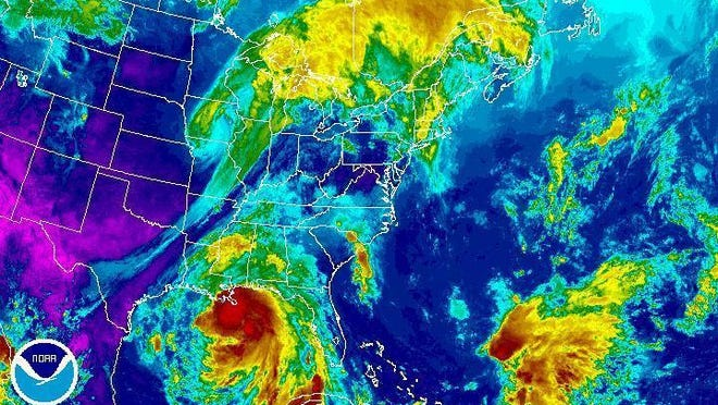 This enhanced infrared satellite image made available by the National Oceanic and Atmospheric Administration shows Hurricane Nate in the Gulf of Mexico on Saturday, Oct. 7, 2017 at 2:15 p.m. EDT. Coastal residents from southeast Louisiana to the Florida panhandle braced for the effects of the fast-moving hurricane, expected to hit sometime time Saturday night. (NOAA via AP)