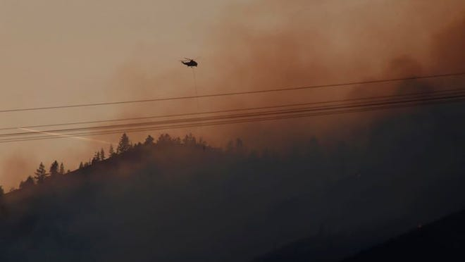 Helicopters attacked the Badger Fire from above Saturday evening, July 18, 2020.