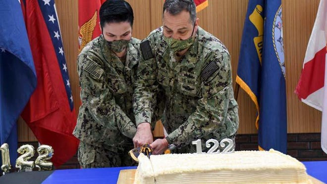 Naval Medical Center Camp Lejeune recently held a cake cutting celebration to honor the 122nd Hospital Corps birthday. As is tradition, the birthday cake was cut by both the most junior and senior sailors in the command, pictured are HN Sarah Pernsteiner and HMCS Victor Ibarra.