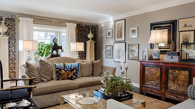 Antique Indonesian panels flank the window in the living room, which was painted taupe (similar to Sherwin Williams' Taupe Tone) and outfitted with an old Chinese chest.