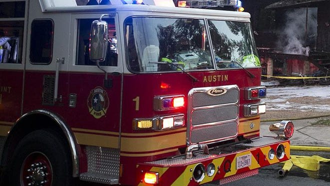 Austin firefighters investigate a fatal fire on Mariposa Drive on Monday.