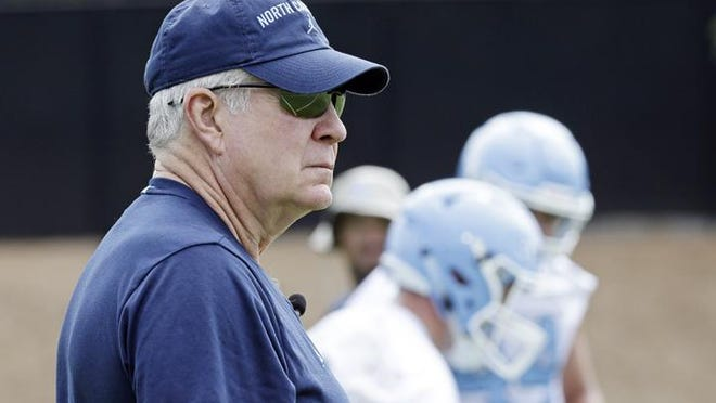 North Carolina coach Mack Brown agreed to have his salary cut by 20% due to the COVID-19 pandemic, but university records show that percentage was on his base salary -- $750,000. Brown's overall compensation is $3.5 million.