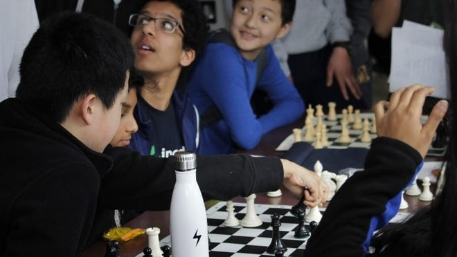 Students play chess during a break at the 2019 ABMC competition.