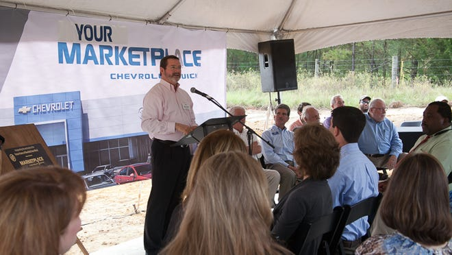 Mansfield Auto World owner James Lynch addresses invited guests at Thursday's groundbreaking ceremony in Stonewall.