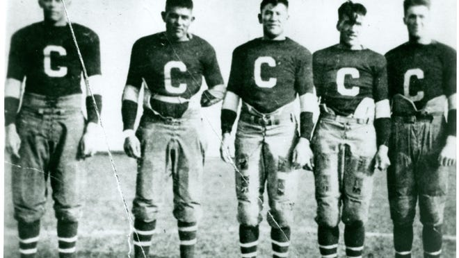 Jim Thorpe (center) and Joe Guyon (second from right) were Native Americans who teamed together on the Canton Bulldogs in 1919 and 1920.