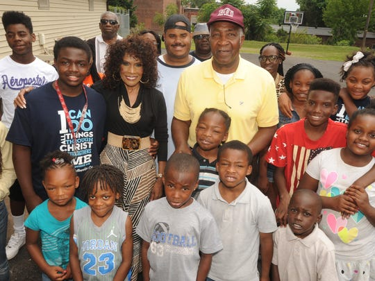 File photo: The Reverends Robbie Williams and L.C. Ray stand with several kids involved in One Youth At A Time several years ago. Derrick Lee, who was fatally shot at the age of 12, is pictured directly in front of Rev. Ray.
