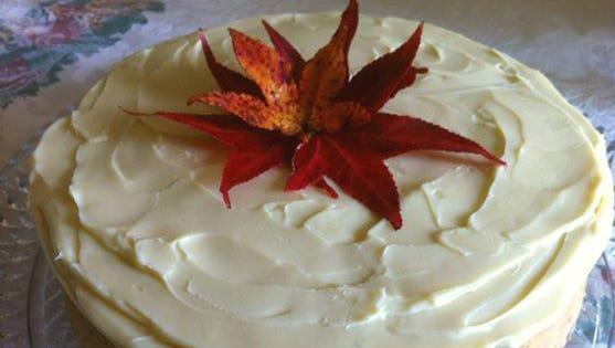 Bourbon white chocolate ganache covers pumpkin cheesecake.