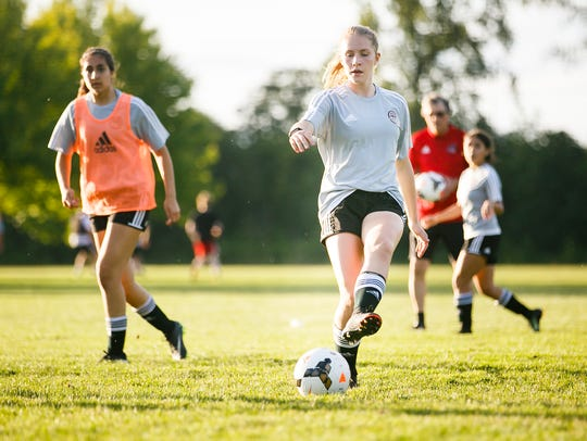 Capital FC Zenith defender Sarah Rice scrimmages with