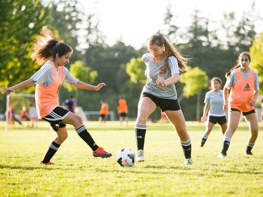 Capital FC Zenith defender Olivia Orozco, center, scrimmages