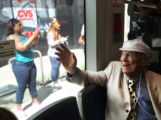 Earl Clark , 93, rides the Cincinnati Bell Connector