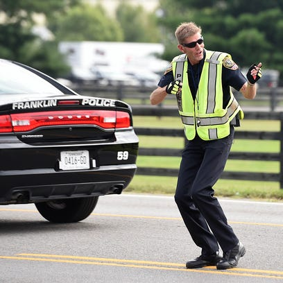 Franklin police officer David Collins directs traffic