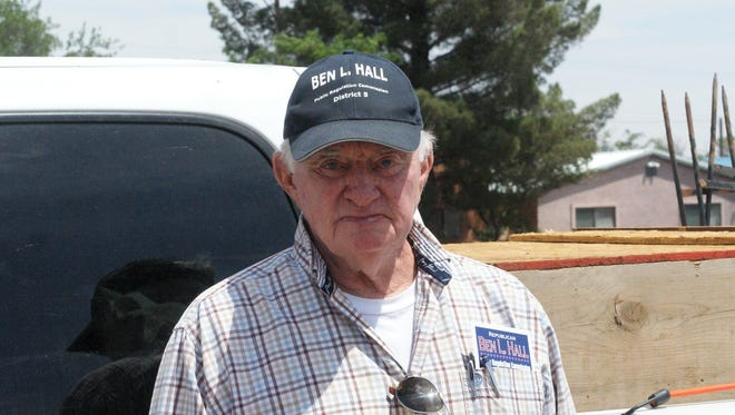 Ben L. Hall stopped in Deming to do maintenance on his campaign signs early in May.