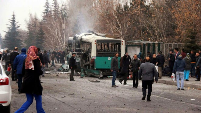 A destroyed public bus  is pictured at the scene of a car bomb attack in central Anatolian city of Kayseri, Turkey on Saturday. Turkish authorities have banned distribution of images relating to the Istanbul explosions within Turkey.