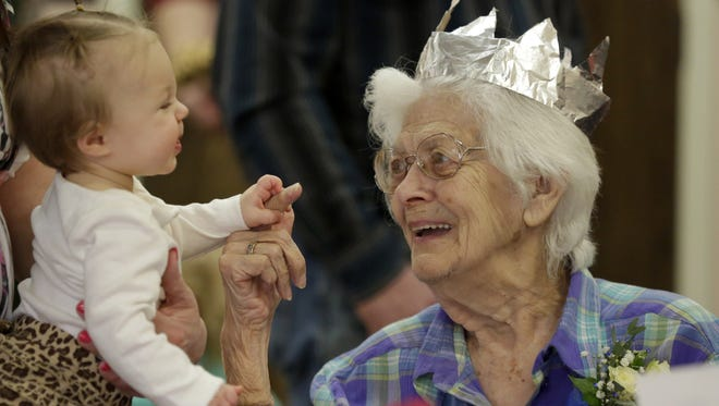 Iola Schwab of Neenah talks to Cheyenne Menne, a great-great-granddaughter as she gathers with generations of family to celebrate turning 100 on the 29th, her 25th birthday, in Neenah, Wis., on Sunday, February 28, 2016.