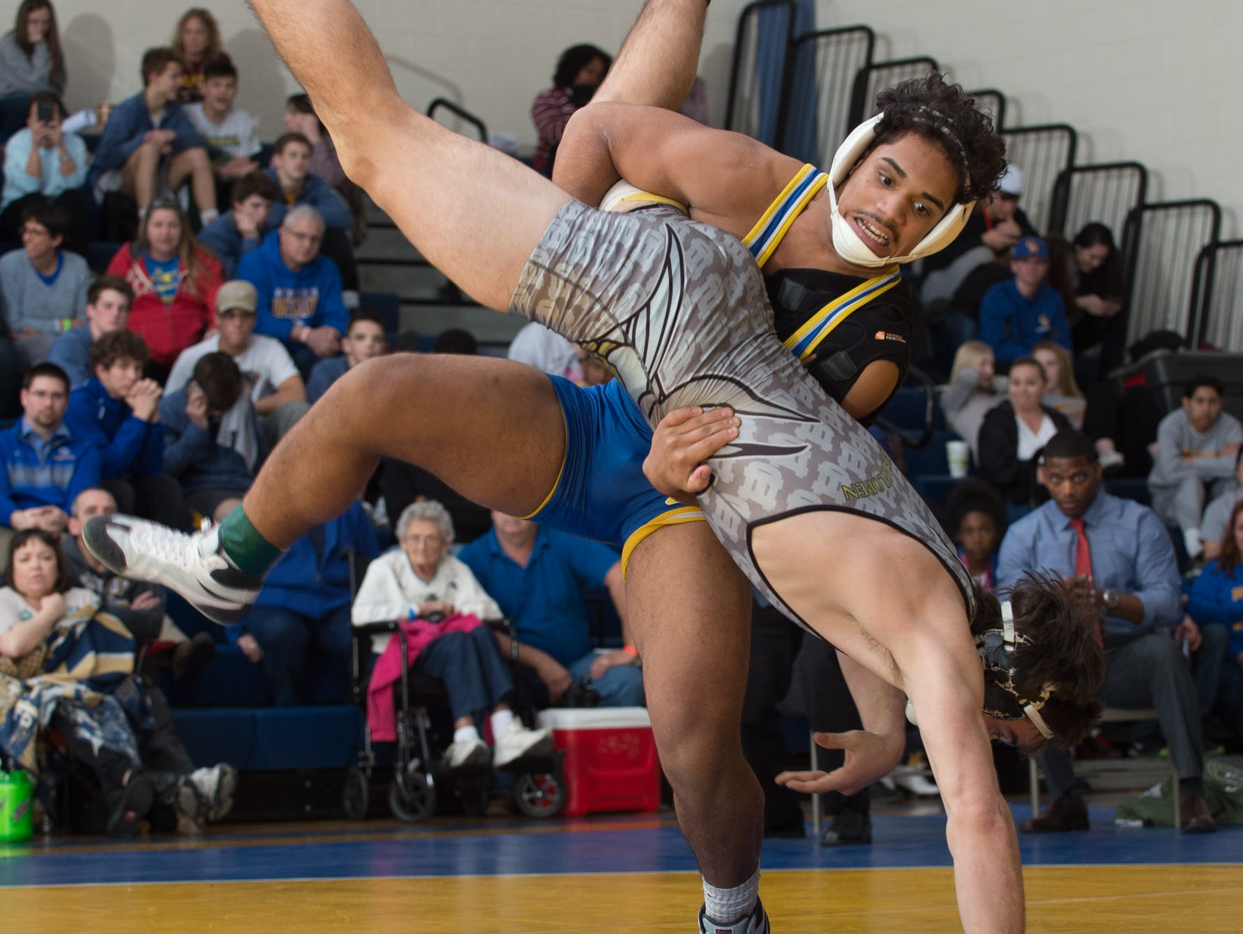 Sussex Central's Brandon Bautista lifts Cape Henlopen's Cory Lawson off the mat in the 160 pound championship match at the Henlopen Conference wrestling tournament at Sussex Central High School.