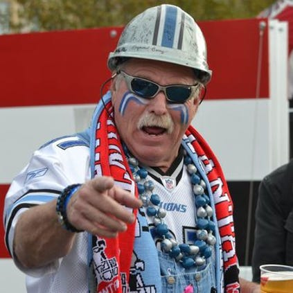A Lions fan shows his pride at the rally at Trafalgar