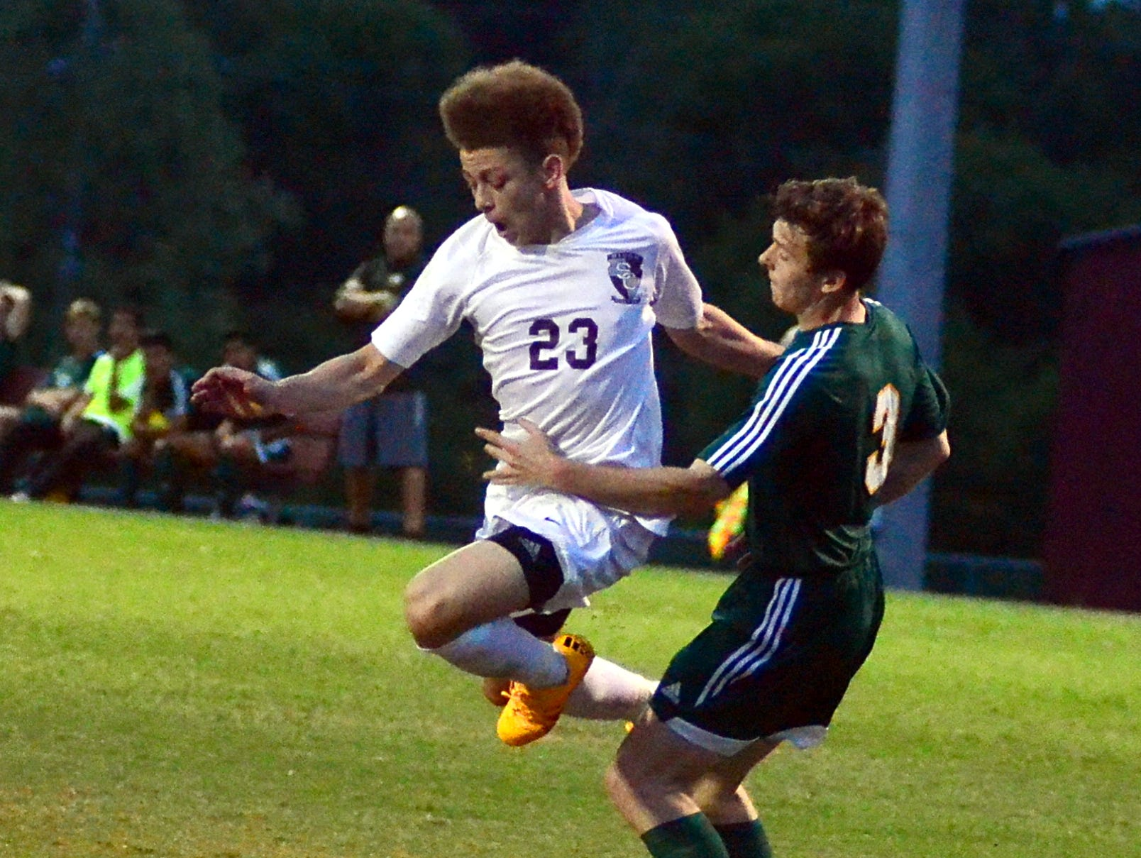 Station Camp High junior Chase Freeman maneuvers past Gallatin senior Tyler Lee during first-half action. Freeman scored twice in the Bison's 2-0 victory over Gallatin on Friday evening.