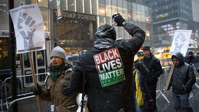 NEW YORK, NY - JANUARY 14: Black Lives Matter activists march in front of Trump Tower on January 14, 2017 in New York City.