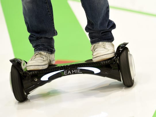 An employee presents a hoverboard by Beamie at the