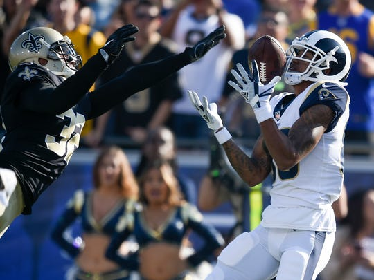 Los Angeles Rams wide receiver Josh Reynolds, right, is unable to make a catch defended by New Orleans Saints safety Kenny Vaccaro during the first half of an NFL football game Sunday, Nov. 26, 2017, in Los Angeles.