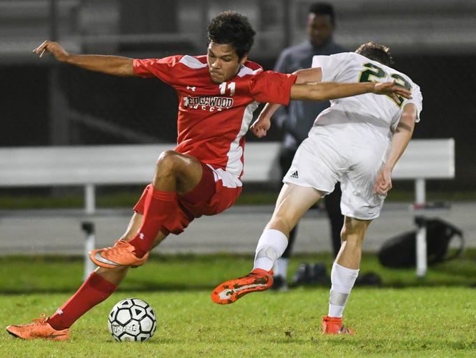 Theo Cox of Edgewood trips over VIera player Corbin