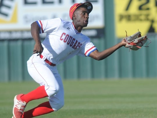 Cooper center fielder makes a running catch on Tommy Williams' fly ball in the fifth inning. Canyon won Class 5A bi-district playoff game 14-3 Friday, May 5, 2017 at Lubbock High's Westerner Field to take a 1-0 lead in the best-of-three series.
