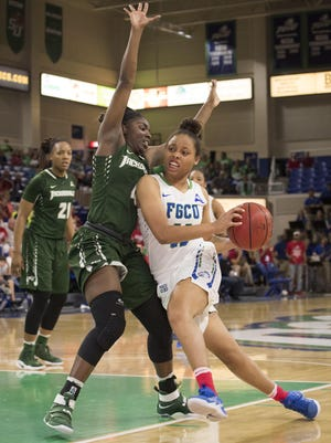 FGCU's Erica Nelson drives past Jacksonville's Brandi Buie during Saturday's 60-57 victory.