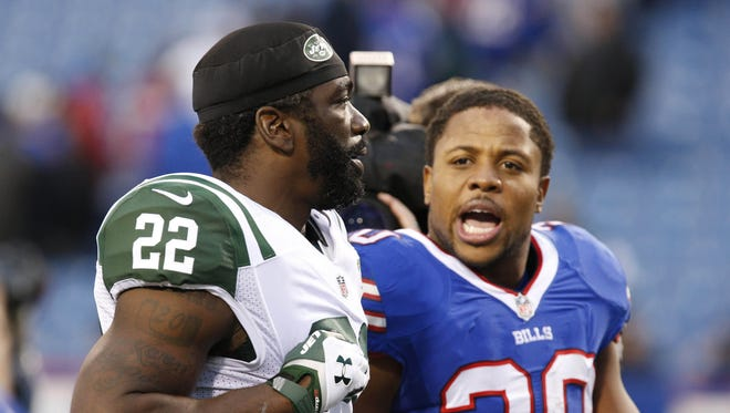 Nov 17, 2013; Orchard Park, NY, USA; New York Jets safety Ed Reed (22) and Buffalo Bills running back Tashard Choice (20) talk as they leave the field after the second half at Ralph Wilson Stadium. Bills beat the Jets 37-14. Mandatory Credit: Kevin Hoffman-USA TODAY Sports
