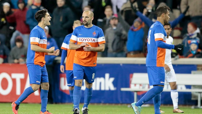 From left: FC Cincinnati's Ross Tomaselli, Paul Nicholson and Kenny Walker celebrate the 2-1 win against the Charlotte Independence (1-1-0), Saturday, April 9, 2016, at Nippert Stadium in Cincinnati. FC Cincinnati won 2-1.