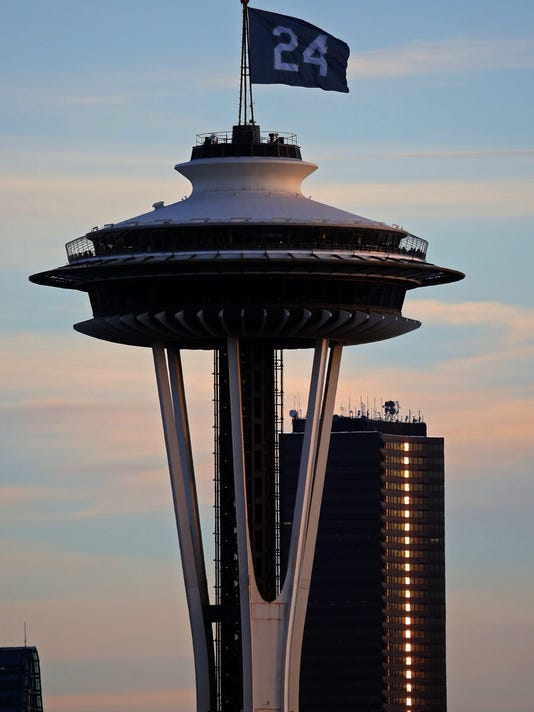 A No. 24 flag atop the Space Needle in Seattle honor of former Seattle Mariners player Ken Griffey Jr., who was elected Wednesday, Jan. 6, 2016, to the Baseball Hall of Fame. (Ken Lambert/The Seattle Times via AP)