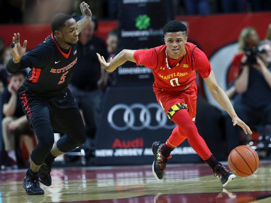 Maryland guard Anthony Cowan (0) bring the ball up