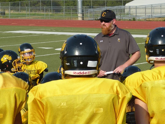 Enterprise coach Russell McWilliams addresses his team after practice last season.