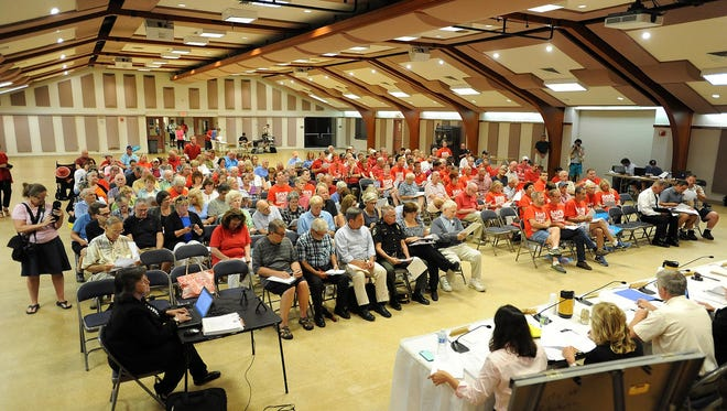 A crowd of over 200 attended as protesters wearing red shirts and carrying signs opposed a pending pool ordinance vote by the Rehoboth Beach City Commissioners on Friday, June 19.