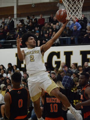 Abilene High's David Russell goes up for a layup during the Eagles' 62-59 win over Haltom City Haltom on Friday, Jan. 13, 2018, at Eagle Gym.