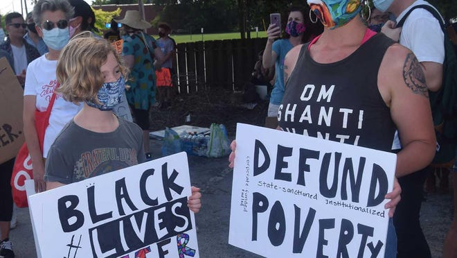 Signs suggest ideas for change and solutions to racism, as was the case at the New Bern against Racism rally on June 7 in New Bern.