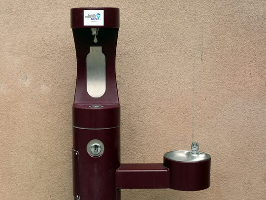 A water fountain and water bottle filling station at
